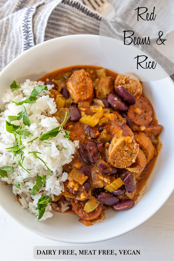 A Pinterest pin for vegan red beans and rice with a picture of a white bowl with half rice and half red beans and sausage.