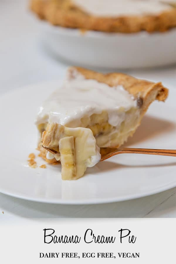 A Pinterest pin for vegan banana cream pie with a slice of the pie on a white plate and a copper fork with pie on it.