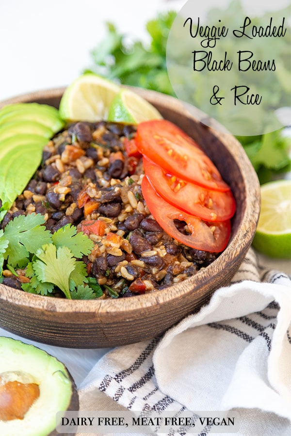 A PInterest pin for black beans and rice with a picture of the recipe in a brown wood bowl.