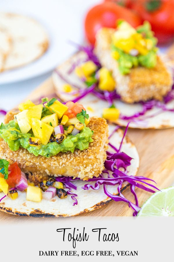 A Pinterest pin for vegan fish tacos with a picture of the tacos on a wooden board.